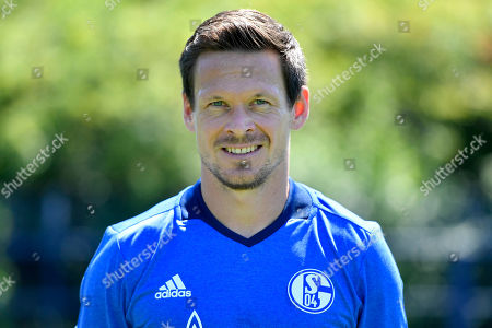 Schalke's Sascha Riether of FC Schalke 04 poses for the official team photo for the new season at the Veltins-Arena in Gelsenkirchen, Germany