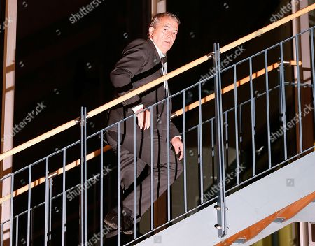 Then President of German soccer federation Wolfgang Niersbach walks upstairs after announcing that he steps back from his post as president in Frankfurt, Germany. FIFA Council member Wolfgang Niersbach receives 1-year ban in 2006 World Cup investigation as it was announced