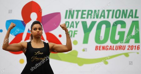 Bipasha Basu Bollywood actress Bipasha Basu gestures as she performs yoga at an event to celebrate International Yoga Day in Bangalore, India, . Millions of yoga enthusiasts are bending their bodies in complex postures across India as they take part in a mass yoga program to mark the second International Yoga Day