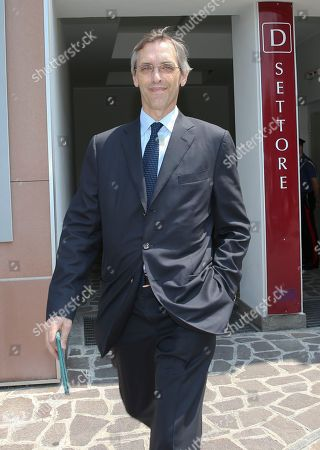 Lawyer Niccolo' Ghedini leaves the San Raffaele hospital in Milan, Italy, where ex-Premier Silvio Berlusconi has been hospitalized for scheduled tests after doctors discovered a small irregular heartbeat during an earlier appointment