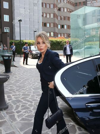 Marina Berlusconi arrives at the San Raffaele hospital in Milan, Italy, where her father, the ex-Premier Silvio Berlusconi, has been hospitalized since Tuesday for scheduled tests after doctors discovered a small irregular heartbeat during an earlier appointment