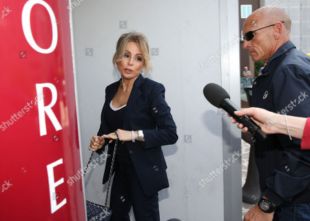 Marina Berlusconi arrives at the San Raffaele hospital in Milan, Italy, where her father, ex-Premier Silvio Berlusconi has been hospitalized since Tuesday for scheduled tests after doctors discovered a small irregular heartbeat during an earlier appointment