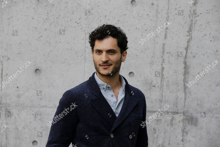Actor Alessandro Tersigni poses as he arrives to attend the Giorgio Armani men's Spring-Summer 2016-2017 fashion show, that was presented in Milan, Italy