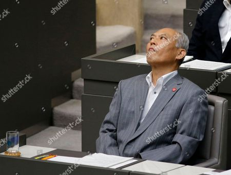 Yoichi Masuzoe Tokyo Gov. Yoichi Masuzoe looks up at the beginning of the Tokyo metropolitan assembly in Tokyo, . Japanese media reports say Masuzoe submitted his resignation on Wednesday, June 15, 2016, over a political funds scandal. Earlier reports said it would take effect June 21
