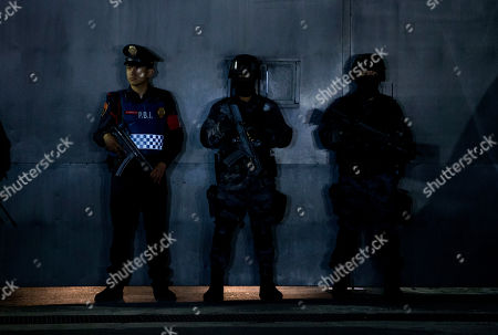 """Police stand guard outside the entrance gate to the airport hangar of Mexico's Attorney General office, in Mexico City, during the arrival of drug lord Hector """"El Guero"""" Palma, . Palma, one of the founders of the Sinaloa Cartel, returned to his native country Wednesday after serving almost a decade in a U.S. prison. U.S. authorities handed over Palma in Matamoros, across the border from Brownsville, Texas, before flying him to Mexico City for transfer to Altiplano maximum security prison"""