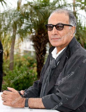 "Abbas Kiarostami Iranian film director Abbas Kiarostami poses during a photo call for Like Someone in Love at the 65th international film festival, in Cannes, southern France. Iran's official news agency IRNA says Kiarostami, whose 1997 film ""Taste of Cherry"" won the Palme d'Or, died, in Paris, where he had gone for cancer treatment. He was 76"