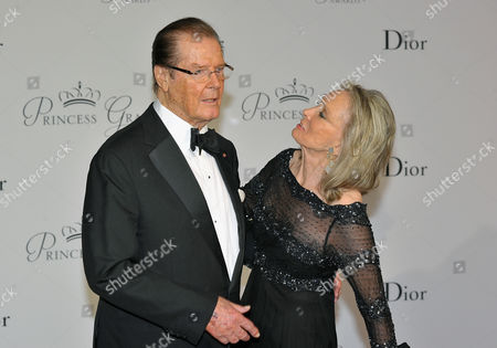 Actor Roger Moore, left, and his wife Kristina Tholstrup pose on the red carpet as they arrive at the Monaco palace to attend the Princess Grace Foundation gala in Monaco. Moore announced the death of Tholstrup's daughter, Christina Knudsen, on social media and his official website