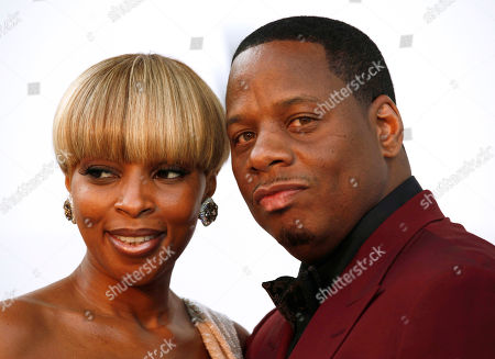 Mary J. Blige, Martin Kendu Isaacs Singer Mary J. Blige and her husband, Martin Kendu Isaacs, arrive for the amfAR Cinema Against AIDS benefit during the 63rd Cannes international film festival, in Cap d'Antibes, southern France. Blige is ending her marriage to her husband-manager after nearly 13 years. Court records show the singer filed for divorce from Isaacs, is Los Angeles, citing irreconcilable differences