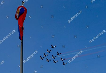 Philippine Air Force S-211 trainer planes make a flyby during flag-raising and wreath-laying rites to celebrate the 118th Philippine Independence Day at the Rizal Park in Manila, Philippines. Philippine President Benigno Aquino III led the rites for the last time as he is to relinquish his presidency to President-elect Rodrigo Duterte at the end of the month