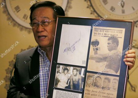 "Romulo ""Romy"" Macalintal Filipino lawyer Romulo ""Romy"" Macalintal displays the autographed pages of his scrapbook containing news clippings on the legendary boxer Muhammad Ali's fights within the 15-year period in Pasay city, south of Manila, Philippines. Macalintal is proud of himself to have had an audience with ""the Champ"" and sought his autographs while Ali was in the Philippines for training that led to his 1975 ""Thrilla in Manila"" heavyweight fight win over Joe Frazier. Ali passed away on June 3 at the age of 74"
