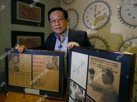 "Romulo ""Romy"" Macalintal Filipino lawyer Romulo ""Romy"" Macalintal displays framed autographed pages of his scrapbook containing news clippings on the legendary boxer Muhammad Ali's fights within the 15-year period in Pasay city, south of Manila, Philippines. Macalintal is proud of himself to have had an audience with ""the Champ"" and sought his autographs while Ali was in the Philippines for training that led to his 1975 ""Thrilla in Manila"" heavyweight fight win over Joe Frazier. Ali passed away on June 3 at the age of 74"