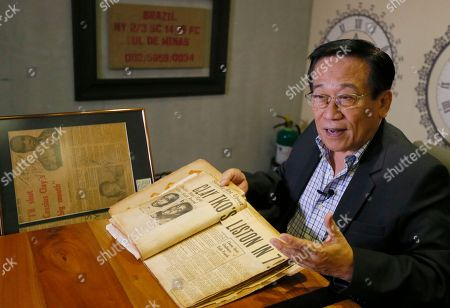 "Romulo ""Romy"" Macalintal Filipino lawyer Romulo ""Romy"" Macalintal scans pages of his scrapbook containing news clippings on the legendary boxer Muhammad Ali's fights within the 15-year period in Pasay city, south of Manila, Philippines. Macalintal is proud of himself to have had an audience with ""the Champ"" and sought his autographs while Ali was in the Philippines for training that led to his 1975 ""Thrilla in Manila"" heavyweight fight win over Joe Frazier. Ali passed away on June 3 at the age of 74"