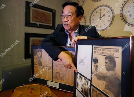 "Romulo ""Romy"" Macalintal Filipino lawyer Romulo ""Romy"" Macalintal points the photo of himself with the legendary boxer Muhammad Ali while showing framed news clippings of Ali's fights within the 15-year period in Pasay city, south of Manila, Philippines. Macalintal is proud of himself to have had an audience with ""the Champ"" and sought his autographs while Ali was in the Philippines for training that led to his 1975 ""Thrilla in Manila"" heavyweight fight win over Joe Frazier. Ali passed away on June 3 at the age of 74"