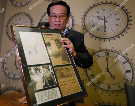 "Romulo ""Romy"" Macalintal Filipino lawyer Romulo ""Romy"" Macalintal displays a framed autographed pages of his scrapbook containing news clippings on the legendary boxer Muhammad Ali's fights within the 15-year period in Pasay city, south of Manila, Philippines. Macalintal is proud of himself to have had an audience with ""the Champ"" and sought his autographs while Ali was in the Philippines for training that led to his 1975 ""Thrilla in Manila"" heavyweight fight win over Joe Frazier. Ali passed away on June 3 at the age of 74"