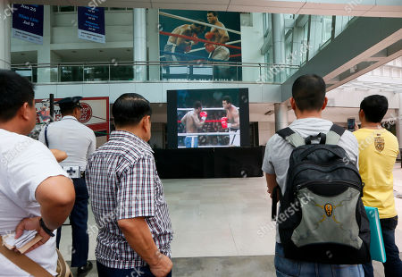 "Filipino fans watch the video of the Oct.1, 1975 ""Thrilla in Manila"" World Heavyweight boxing fight between Muhammad Ali and Joe Frazier at the launch of an exhibit at The Ali Mall and Smart Araneta Coliseum in suburban Quezon city northeast of Manila, Philippines . The exhibit was launched to pay tribute to Muhammad Ali who died exactly a week ago Friday. The fight was dubbed the ""Most Legendary Fight in History"