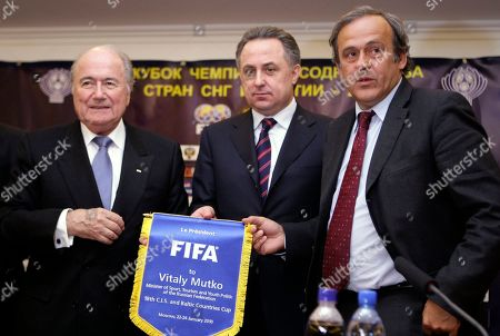 Sepp Blatter, Vitaly Mutko, Michel Platini From left, then FIFA president Sepp Blatter, Russian Sports Minister Vitaly Mutko, who was the Russian Football Union president in 2005-2009, and then UEFA president Michel Platini seen after Russia's Rubin Kazan victory over Kazakhstans's Aktobe at their final soccer match of the 18th CIS and Baltic Cup match. Russian President Vladimir Putin said the officials named in a new report as directly responsible for widespread doping will be suspended pending a thorough investigation in Russia. Putin gave no names, but his statement appears to apply to Sports Minister Vitaly Mutko and his deputy, Yuri Nagornykh, who are both discussed in the report