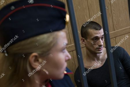 Pyotr Pavlensky Russian artist Pyotr Pavlensky sits in a cage in a court room in Moscow on . The court started a final hearing for Russian performance artist Pyotr Pavlensky on vandalism charges after he set fire to the doors of the FSB (Federal Security Service) headquarters in Moscow