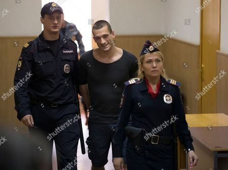 Pyotr Pavlensky Pyotr Pavlensky, center, is escorted to a court room in Moscow on . The court started a final hearing for Russian performance artist Pyotr Pavlensky on vandalism charges after he set fire to the doors of the FSB (Federal Security Service) headquarters in Moscow
