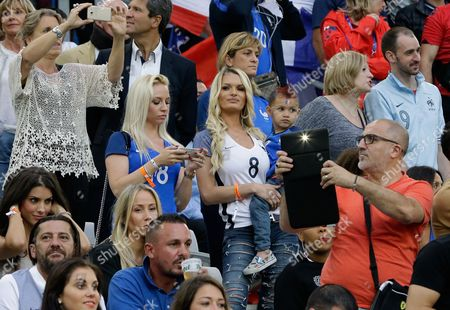 Ludivine Payet, wife of France's Dimitri Payet, wears a shirt with her husband's number 8 on the stands before the Euro 2016 Group A soccer match between France and Albania at the Velodrome stadium in Marseille, France