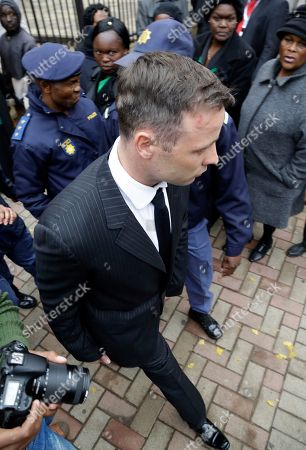 Oscar Pistorius, leaves after the first day of his sentencing hearing at the High Court in Pretoria, South Africa, . Pistorius appeared in a South African court on Monday for a sentencing hearing after the double-amputee Olympian was convicted of murdering girlfriend Reeva Steenkamp. Defense lawyer Barry Roux argued for some leniency and called a psychologist who evaluated Pistorius to testify
