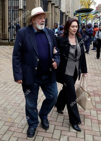 Reeva Steenkamp's father Barry Steenkamp, with an unidentified woman, leaves after the first day of the sentencing hearing for Oscar Pistorius, in the High Court in Pretoria, South Africa, . Pistorius appeared in a South African court on Monday for a sentencing hearing after the double-amputee Olympian was convicted of murdering girlfriend Reeva Steenkamp. Defense lawyer Barry Roux argued for some leniency and called a psychologist who evaluated Pistorius to testify