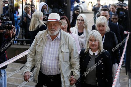 Stock Image of Reeva Steenkamp's father Barry Steenkamp, left, with wife June, arrives at the High Court in Pretoria, South Africa, for the sentencing proceedings of Oscar Pistorius. An appeals court found Pistorius guilty of murder, and not culpable homicide, for the shooting death of his girlfriend Reeva Steenkamp