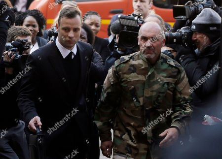 Oscar Pistorius Oscar Pistorius, left, arrives at the High Court in Pretoria, South Africa, for his sentencing proceedings. Kim Martin, a cousin of Reeva Steenkamp, has testified in the South African court at the sentencing hearing for Pistorius, who was convicted of murdering girlfriend Steenkamp in his home in 2013
