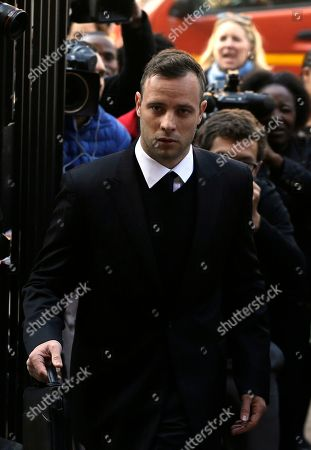 Oscar Pistorius, arrives at the High Court in Pretoria, South Africa, for his sentencing proceedings. An appeals court found Pistorius guilty of murder, and not culpable homicide for the shooting death of his girlfriend Reeva Steenkamp