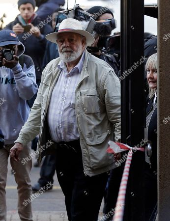 Stock Photo of Reeva Steenkamp's father Barry Steenkamp and his wife June, right, arrive at the High Court in Pretoria, South Africa, for the sentencing proceedings of Oscar Pistorius. An appeals court found Pistorius guilty of murder, and not culpable homicide for the shooting death of his girlfriend Reeva Steenkamp