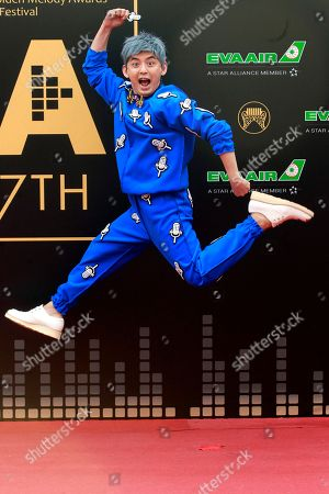 Mickey Huang Taiwanese host Mickey Huang jumps as he arrives at the 27th Golden Melody Awards in Taipei, Taiwan, . Huang is a host at this year's Golden Melody Awards, one of the world's biggest Chinese-language pop music annual events