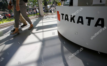 """Visitors walk by a Takata Corp. desk at an automaker's showroom in Tokyo. The National Highway Traffic Safety Administration said, it is urging owners of 313,000 older Hondas and Acuras to stop driving them and get them repaired after new tests found that their Takata air bag inflators are extremely dangerous. The agency's urgent advisory covers 2001 and 2002 Honda Civics and Accords, the 2002 and 2003 Acura TL, the 2002 Honda Odyssey and CR-V, and the 2003 Acura CL and Honda Pilot, NHTSA said. """"These vehicles are unsafe and need to be repaired immediately,"""" Transportation Secretary Anthony Foxx said in a statement. """"Folks should not drive these vehicles unless they are going straight to a dealer to have them repaired"""