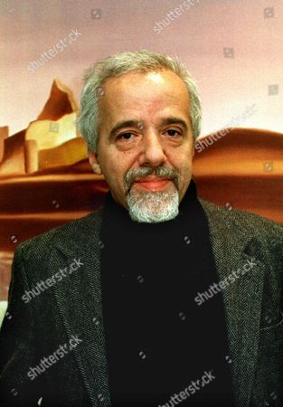 COELHO Writer Paulo Coelho poses in his office in Rio De Janeiro, Brazil, in this undated photo. With some 28 million books sold in 45 languages and more than 120 countries, Coelho is by far Brazil's most widely read author. Coelho's fans include Julia Roberts, Madonna and even President Clinton