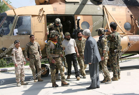 Ali Haidar Gilani, son of former Pakistani Prime Minister Yusuf Raza Gilani, center, emerges from a helicopter as he arrives at the Afghan Ministry of Defense in Kabul, . Gilani, who was freed from kidnappers in a dramatic military rescue in Afghanistan has been handed over to Pakistan's ambassador in Kabul
