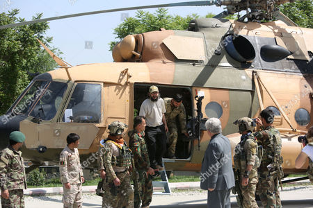 Ali Haidar Gilani, son of former Pakistani Prime Minister Yusuf Raza Gilani, emerges from helicopter as he arrives at the Afghan Ministry of Defense in Kabul, Afghanistan, . Gilani, who was freed from kidnappers in a dramatic military rescue in Afghanistan has been handed over to Pakistan's ambassador in Kabul