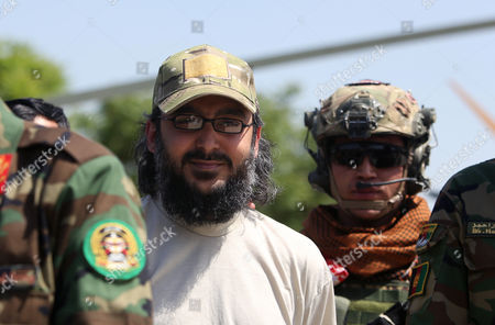 Ali Haidar Gilani, center, son of former Pakistani Prime Minister Yusuf Raza Gilani, stands with Afghan Special Forces as he arrives at the Afghan Ministry of Defense in Kabul, Afghanistan, . Gilani, who was freed from kidnappers in a dramatic military rescue in Afghanistan has been handed over to Pakistan's ambassador in Kabul