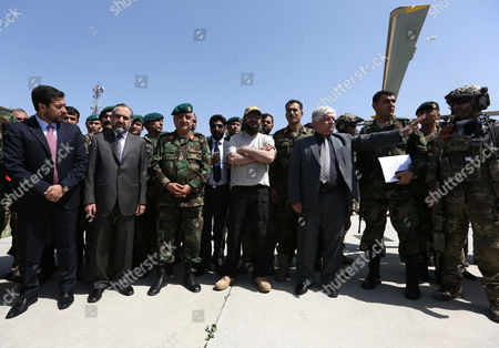 Ali Haidar Gilani, center, son of former Pakistani Prime Minister Yusuf Raza Gilani, center, stands with Afghan and Pakistani officials as he arrives at the Afghan Ministry of Defense in Kabul, Afghanistan, . Gilani, who was freed from kidnappers in a dramatic military rescue in Afghanistan has been handed over to Pakistan's ambassador in Kabul