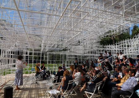 People take part at an inauguration ceremony of the 541 sq. meter (650 sq. yards) steel and bicarbonate tube structure made by the Japanese author Sou Fujimoto as a space for entertainment activities, raised in front of the Gallery of Arts in the Albanian capital, Tirana