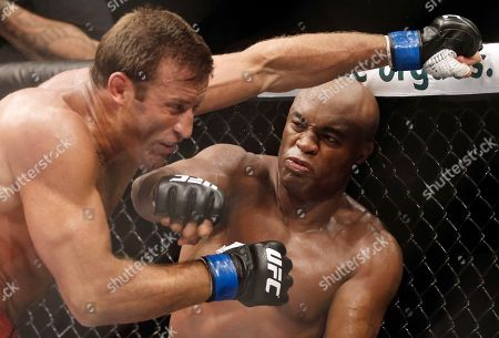 Anderson Silva, Stephan Bonnar Brazil's Anderson Silva, right, throws a punch at Stephan Bonnar, of the United States, during their light heavyweight mixed martial arts bout at UFC 153 in Rio de Janeiro, Brazil. Former UFC middleweight champion Anderson Silva has withdrawn from his scheduled fight against Uriah Hall of Jamaica, in the city of Curitiba in southern Brazil. Organizers of the event did not provide details for the 41-year-old's decision, and said Hall will not face a different opponent