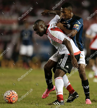 Stock Image of Eder Alvarez Balanta of Argentina's River Plate, left, fights for the ball with Bryan Cabezas of Ecuador's Independiente del Valle during a Copa Libertadores soccer match in Buenos Aires, Argentina