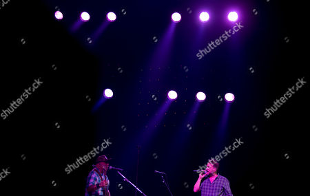 "Vicentico, Flavio Cianciarulo Vicentico, right, and Flavio Cianciarulo, members of the Argentine rock band Los Fabulosos Cadillacs, perform during the group's comeback, in Buenos Aires, Argentina, . The group presented their latest album, ""La Salvación de Solo y Juan"