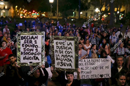 """Demonstrators protest against President Mauricio Macri outside the government in Buenos Aires, Argentina, . An Argentine prosecutor on Thursday asked for an investigation into President Macri's role in offshore companies, adding to the global fallout from a massive leak of documents from a Panama law firm. The signs held by the protesters read in Spanish from left, """"They said they were a team... It turned out they were an illicit association."""" """"Let justice weigh them with the same scales"""