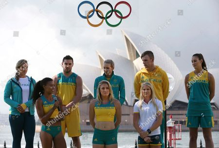 Australian athletes, back row from left to right, Holly Lincoln-Smith, Adam Gibson, Madison Wilson, Kyle Chalmers and Stephanie Talbot, front row left to right, Morgan Mitchell, Sally Pearson and Brooke Stratton model, in Sydney, the uniforms the Australian Olympic team will wear for the Rio 2016 Olympics