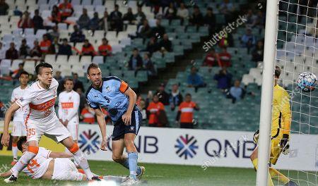 Sydney FC's Matthew Jurman, center, scores a goal against Shandong Luneng Taishan FC of China during their AFC Champions League soccer match in Sydney, Australia