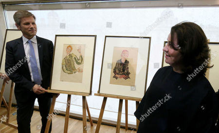 """Stock Picture of Austrian Minister for Arts and Culture Josef Ostermayer and Erika Jakubovits from the Austrian Jewish Community present drawings of Egon Schiele which will be restituted to the heir of Karl Maylaender at the Leopold Museum in Vienna, Austria, . The drawings are from left """"Self-portrait with red hair and striped sleeve guards"""" and """"Seated boy with folded hands"""