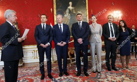Stock Image of Christian Kern, Joerg Leichtfried, Sonja Hammerschmid, Muna Duzdar, Thomas Drozda, Reinhold Mitterlehner Austrian President Heinz Fischer, left, swears in the new members of the Austrian government of the Social Democrats, center from left, Infrastructure Minister Joerg Leichtfried, Education Minister Sonja Hammerschmid, Culture Minister Thomas Drozda and Immigrant State Secretary Muna Duzdar, at the presence of the new Chancellor Christian Kern, second left, and Vice Chancellor Reinhold Mitterlehner, third left, during the inauguration ceremony at the Hofburg palace in Vienna, Austria