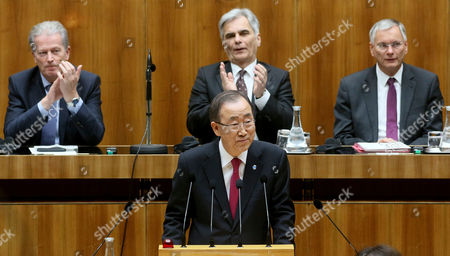 """Ban Ki-moon, Reinhold Mitterlehner, Werner Faymann, Alois Stoeger U.N. Secretary General Ban Ki-moon, center, waves during a session of Austria's lower house at the parliament in Vienna, Austria, . Ban is criticizing restrictions on refugees in Europe, saying they """"negatively impact"""" commitments to international law. Austria's Vice Chancellor Reinhold Mitterlehner, Chancellor Werner Faymann and Social Minister Alois Stoeger, from left, applaud to Ban's speech"""