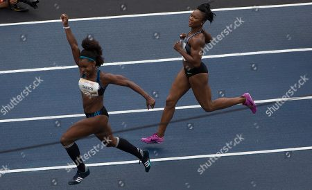 "Rosangela Santos, Carmelita Jeter Brazil's Rosangela Santos celebrates after she crossed the finish line as U.S. Olympic medalist Carmelita Jeter looks on during the ""Mano a Mano"" challenge at the Quinta da Boavista in Rio de Janeiro, Brazil"
