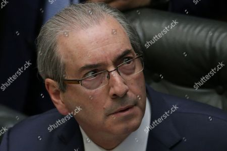 Eduardo Cunha House Speaker Eduardo Cunha, who supports the impeachment of Brazil's President Dilma Rousseff, attends a debate on whether or not to impeachment the president, in the Chamber of Deputies in Brasilia, Brazil, . Solicitor General Jose Eduardo Cardozo alleges that Cunha is striking out at Rousseff for refusing to help him avoid an ethics probe into allegations he received millions in bribes from the sprawling corruption scheme in the Petrobras oil company. The crucial vote is slated for Sunday
