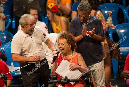 President Luiz Inacio Lula da Silva, Beth Carvalho, Chico Buarque Brazil's former President Luiz Inacio Lula da Silva, left, and Brazilian singers Beth Carvalho, center, and Chico Buarque, right, participate in a gathering in support of Brazil's President Dilma Rousseff, in Rio de Janeiro, Brazil, . A congressional committee voted Monday to recommend that the impeachment process against President Dilma Rousseff move forward, bringing the possible ouster of the embattled leader a step closer