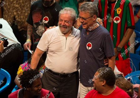 Luiz Inacio Lula da Silva, Chico Buarque Brazil's former President Luiz Inacio Lula da Silva, left, poses for a picture with Brazilian singer Chico Buarque, right, during a gathering with artists and intellectuals in support of Brazil's President Dilma Rousseff, in Rio de Janeiro, Brazil, . A congressional committee voted Monday to recommend that the impeachment process against President Dilma Rousseff move forward, bringing the possible ouster of the embattled leader a step closer